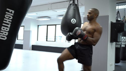 A Kick Boxer Training On Heavy Bags