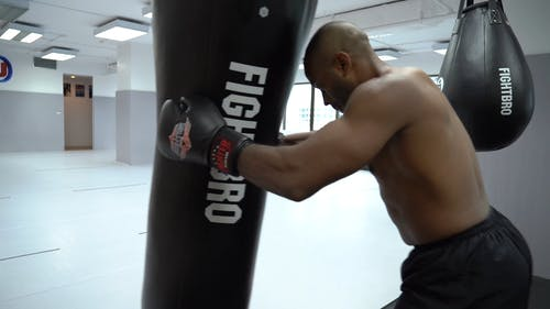 A Kick Boxer Hitting The Heavy Bag With His Knees