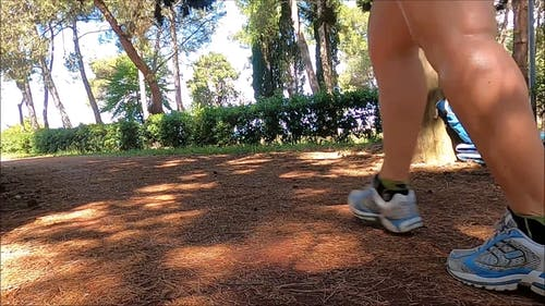 A Woman Walking Outdoors As Exercise
