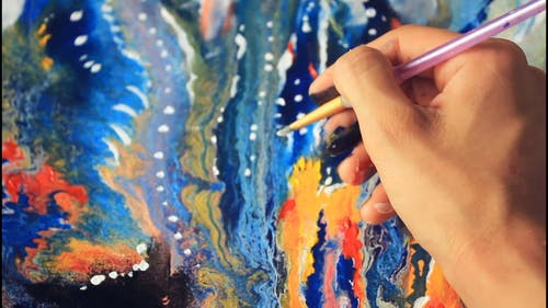 Close-Up Video Of Person Paintig A Canvas