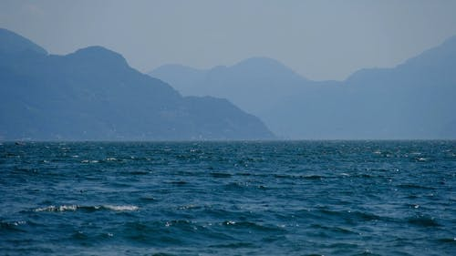 Seascape Scenery Against Mountain Background