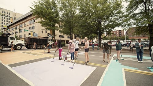 Video Of People Applying Colors On Road