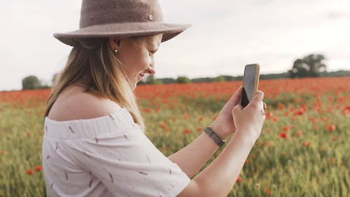Shallow Focus of Woman Holding Her Smartphone