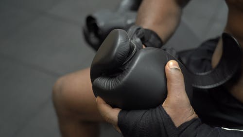 Close-Up View of Person Putting on Boxing Gloves