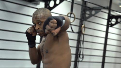 Shirtless Man Punching