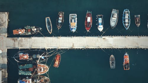 Drone Flying Over The Docking Area Of A Sea Port