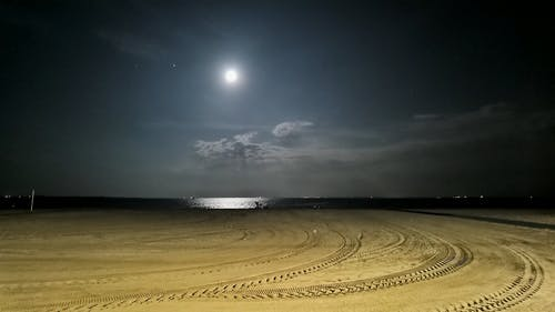 The View Of The Full Moon From The Beach