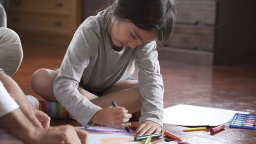 Girl Coloring Her Artwork