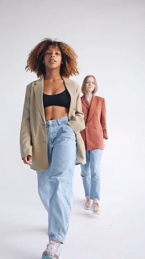 Girls Modeling While Looking at Camera Against White Background