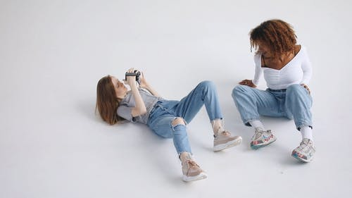 Two Young Women Making A Video Production