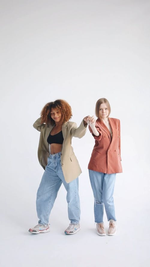 Two Women Holding Hands While Dancing