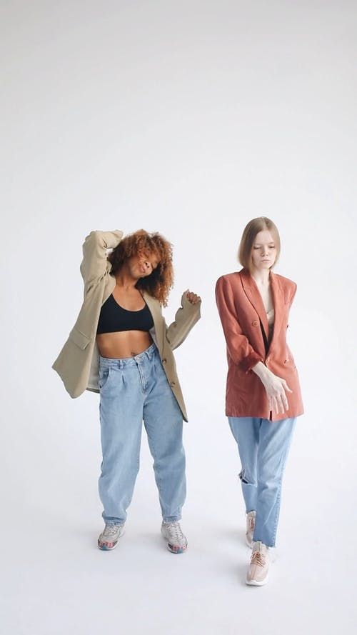 Two Women Dancing Against White Background