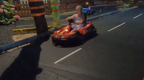 Kids Driving Go Karts In A Track
