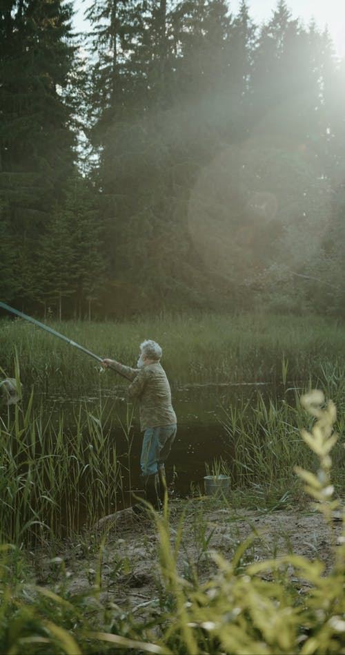 Man Casting His Fishing Rod