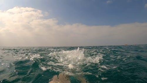 Person Splashing Sea Water Using His Legs