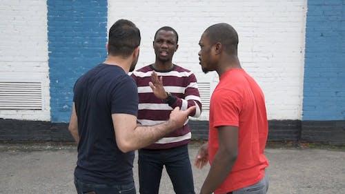 Men Of Different Race Having An Argument