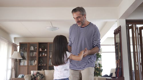 A Father Dancing With Her Little Girl