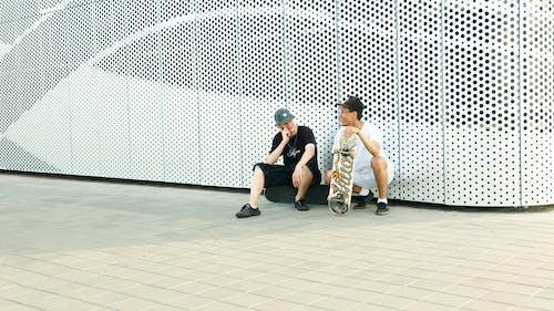 Two Men In A Skateboard Park