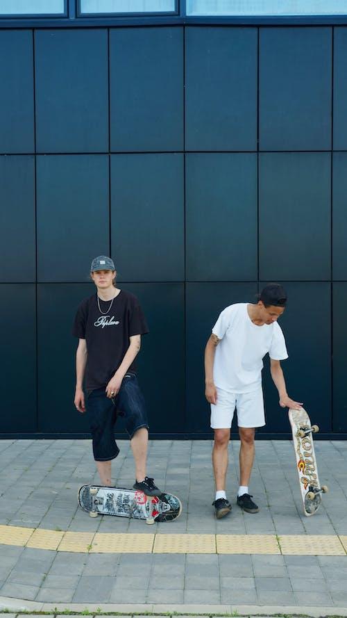 Boys Posing with Their Skateboards