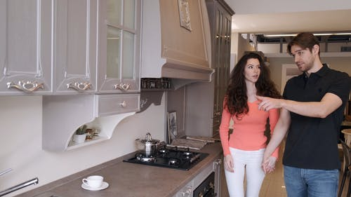 A Couple Checking Out Kitchen Cabinet Designs