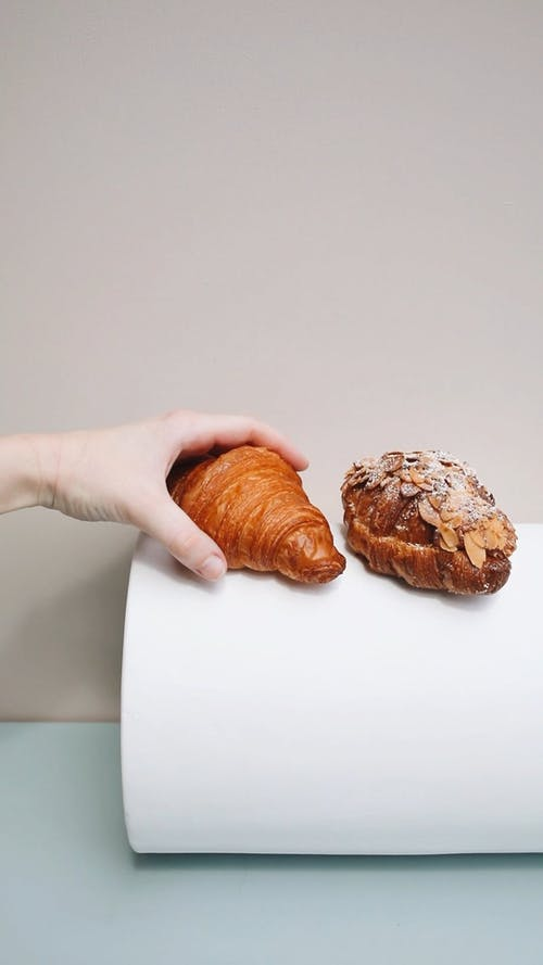 Person Getting a Croissant