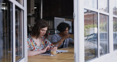 A Woman And A man Having Coffee In A Coffee Shop Counter