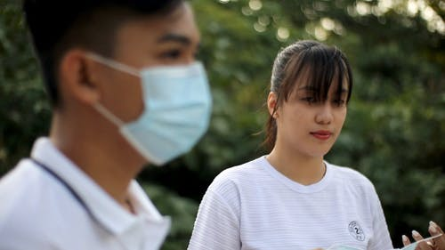 Selective Focus of Woman Wearing Her Face Mask