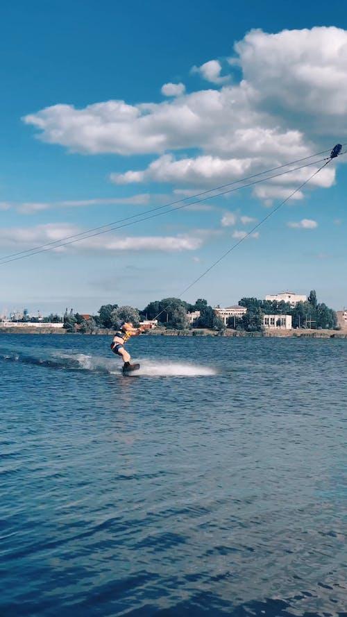 Man Doing Zip Line Wakeboarding
