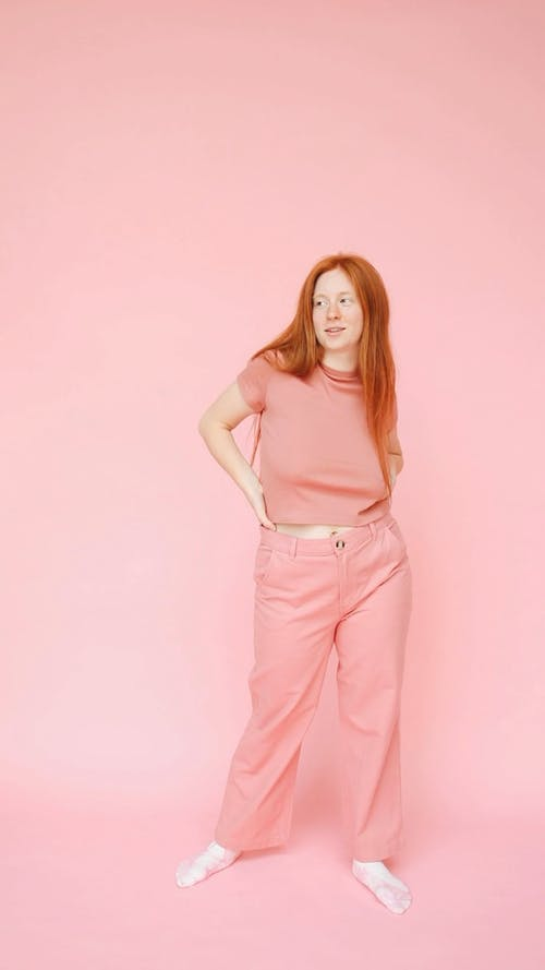 Woman in Pink Shirt and Pink Pants Modeling