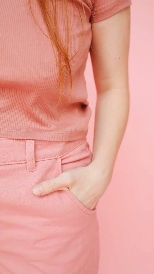 Person Wearing Pink Shirt and Pink Pants