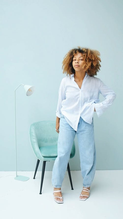 Woman Sitting on Blue Chair