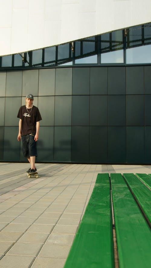 Man Riding a Skateboard Doing Stunt