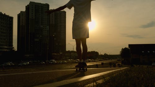 A Young Man Dancing While On His Skateboard