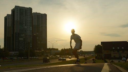 A Young Man Executing A Kick Flip Skateboard Trick