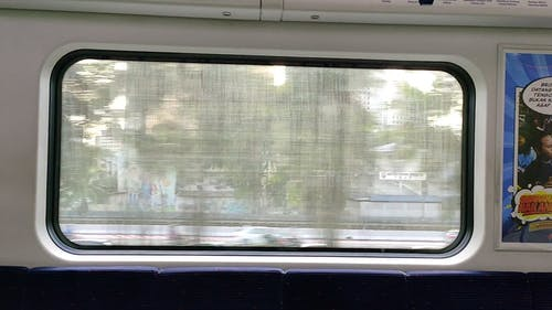 The City Surrounding From Inside A Moving Train