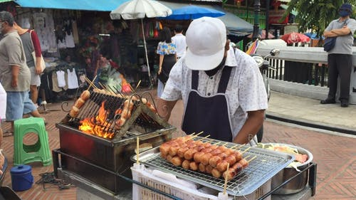 Man Selling a Street Food
