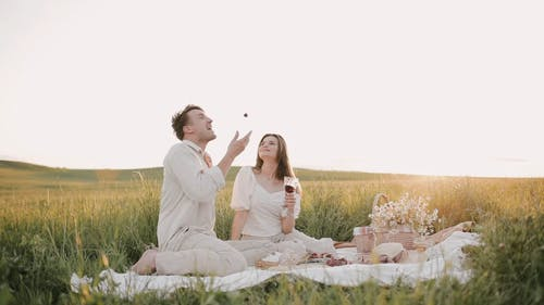 Couple Having Fun With Their Picnic
