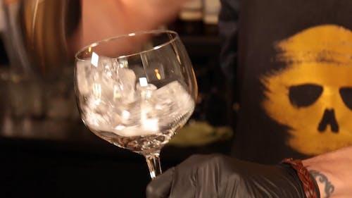 A Bartender Preparing A Glass Of Gin Tonic