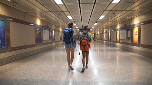 Two Women Walking in a Subway System