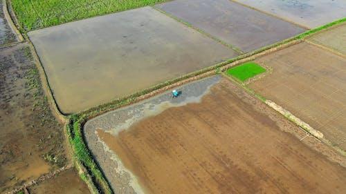 High Angle Shot of Person Tilling His Farmland