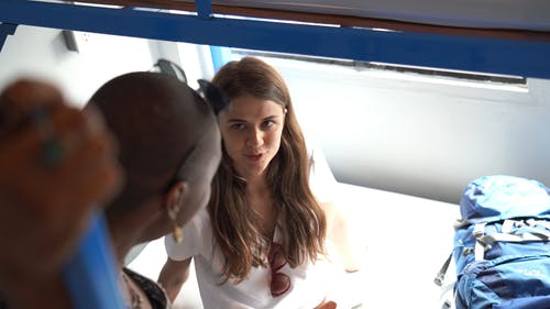 High Angle Shot of Woman in White Shirt Talking to Another Woman