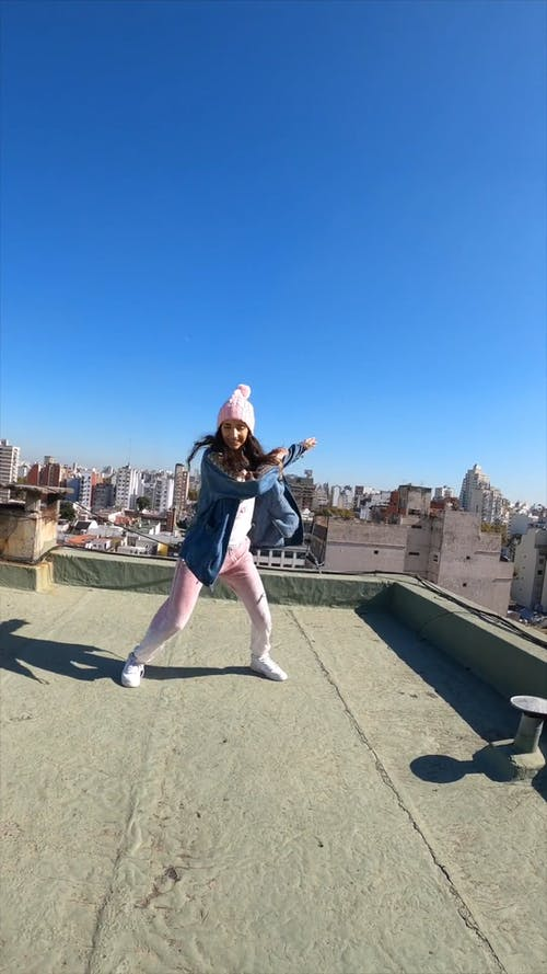 A Girl Dancing On A Rooftop