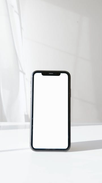 Smartphone On White Surface Against White Background