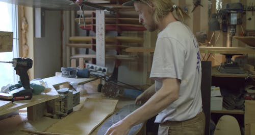A Man Assembling The Skateboard Parts