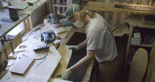 A Man Making A Skateboard