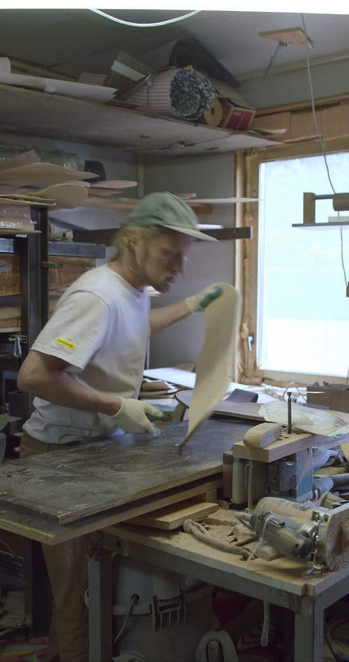 A Craftsman Shaping a Skateboard