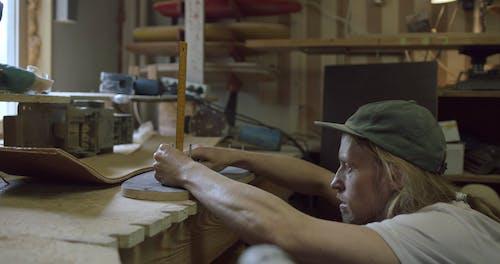 A Craftsman Making a Skateboard in Progress