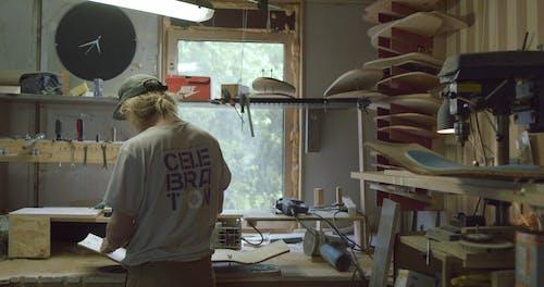 Man Crafting a Skate Board