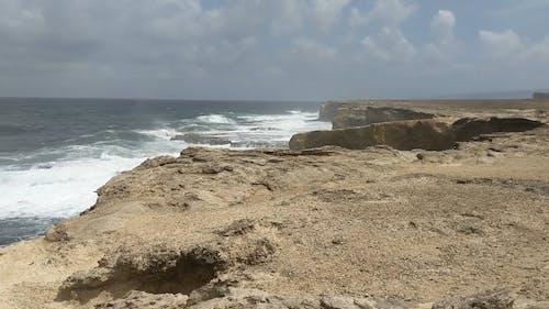 Big Waves Of The Sea Crashing The Rocky Coastline