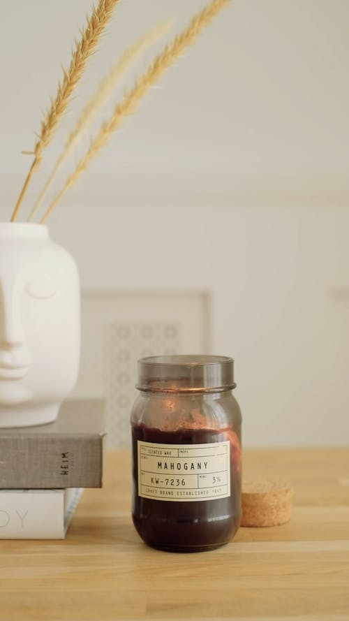 A Flickering Light of a Candle in a Jar